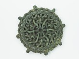 Lid fitting with openwork design of intertwined serpents