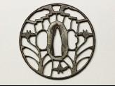 Round tsuba with yatsu-hashi, or eight-bridges, design