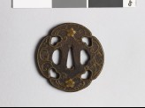 Mokkō-shaped tsuba with karakusa, scrolling floral pattern