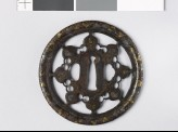 Round tsuba with karakusa, or scrolling plant pattern, interspersed with aoi, or hollyhock leaves