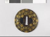 Round tsuba with karakusa, or scrolling floral pattern (EAX.10161)