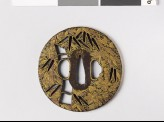 Round tsuba with bamboo and clematis