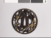 Round tsuba with grape vine and squirrel