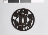 Round tsuba with arrowhead and aoi, or hollyhock leaves