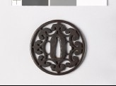 Round tsuba with floriated cusps