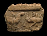 Fragment of a tile with ducks