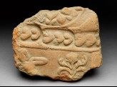Tile fragment with plant and figure