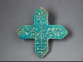 Cross tile with vegetal decoration