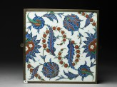 Tile with serrated leaves and flowers