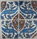 Set of four tiles with tulips, prunus sprays, and serrated leaves (front)