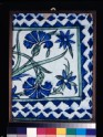 Frieze tile with carnations and irises