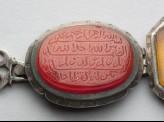 Oval bezel amulet from a bracelet, with thuluth inscription (LI1008.13)