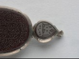 Heart-shaped bezel amulet from a bracelet, with thuluth inscription (LI1008.23)