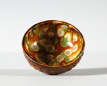 Bowl with floral decoration and a three colour glaze