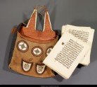 Unbound Qur'an with leather bag