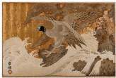 Sea eagle beneath a pine tree on a rocky seashore