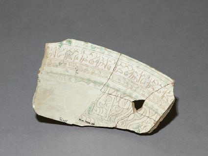 Fragment of a bowl with calligraphic decorationfront