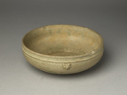Greenware bowl with animal masksoblique