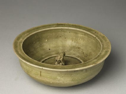 Greenware basin with small kneeling figureoblique