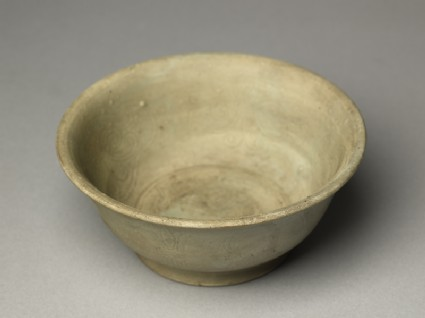 Greenware bowl with phoenix and floral decorationoblique