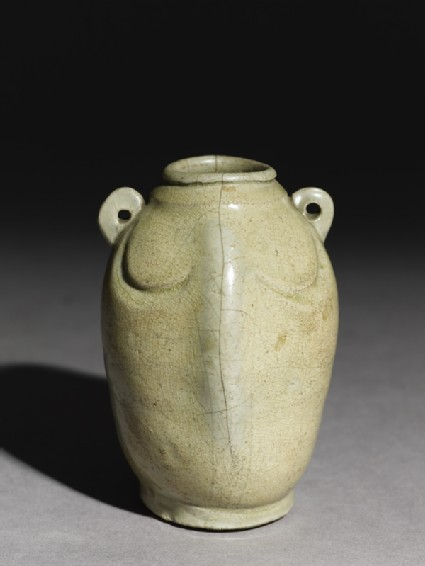 Greenware jar in the form of a double fishoblique