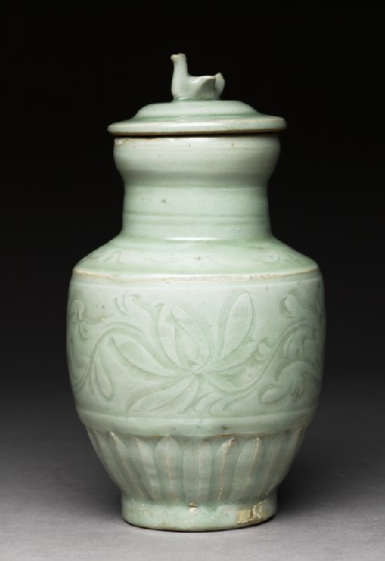 Greenware funerary vase with flowers and a birdside
