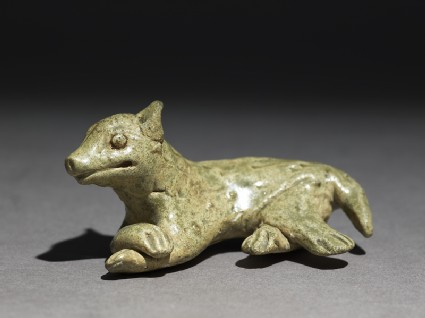 Greenware burial figure of a dogoblique