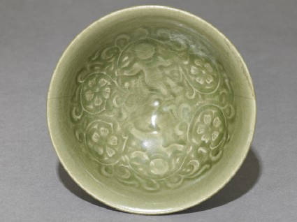 Greenware bowl with boys amid peony scrollstop