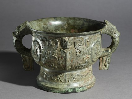 Ritual food vessel, or gui, with coiled figures and taotie masksoblique