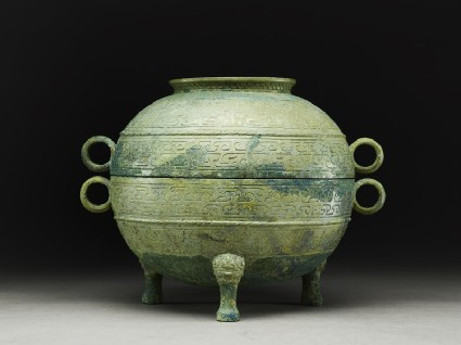 Ritual food vessel, or ding, with abstract and animal designs, and lidside