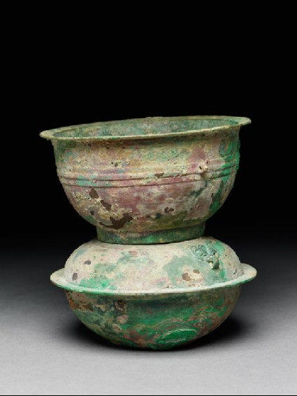 Ritual food vessel, or yan, with animal mask handlesside