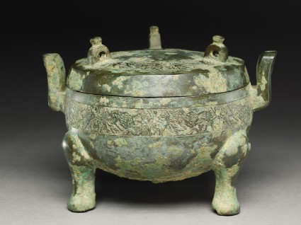 Ritual food vessel, or ding, with hunting scenesoblique