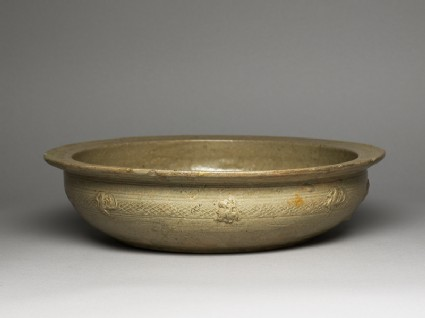 Greenware basin with fish, phoenix, and riding figuresoblique