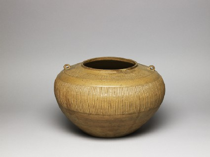Greenware jar with ribbed decorationoblique