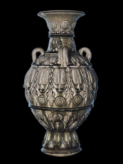 Greenware jar with moulded decorationside