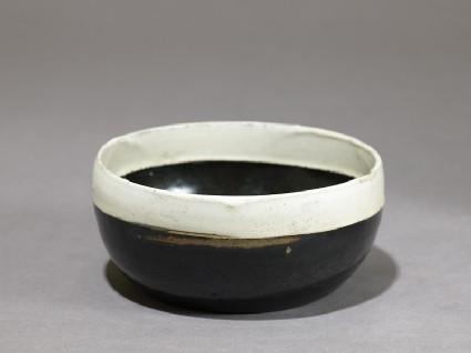 Black ware bowl with white rimoblique