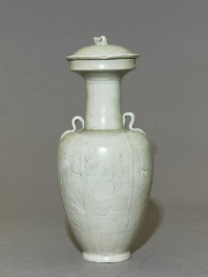 Greenware vase with floral decorationside