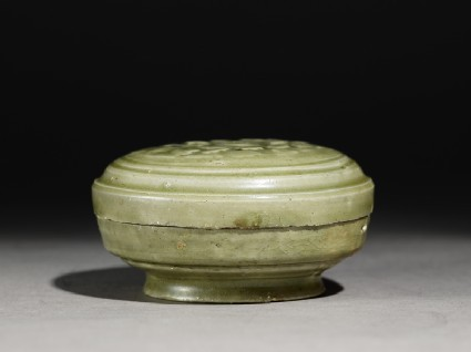 Greenware circular box and lid with floral decorationside