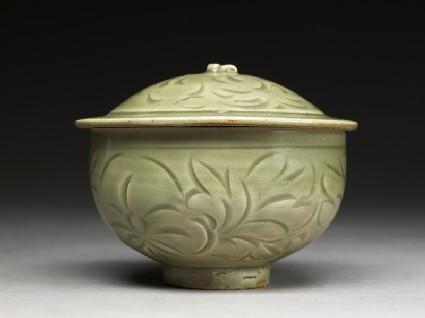 Greenware bowl with floral designside