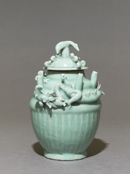 Greenware funerary jar with dragonside
