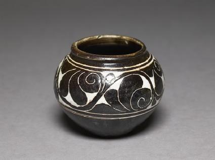 Cizhou type bowl with lotus scroll decorationoblique