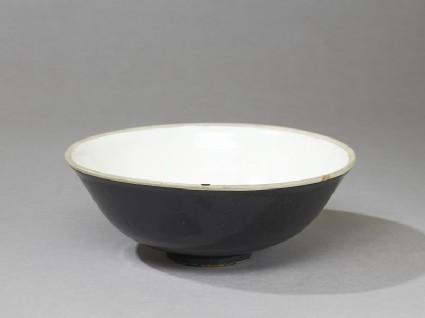 Black ware bowl with white interior and black exterioroblique