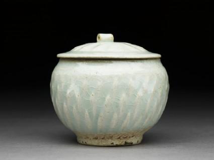 White ware jar with lotus leaf decorationside
