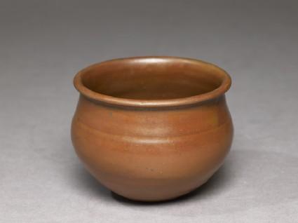 Ding type jar with russet iron glazeoblique