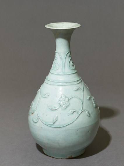 White ware vase with floral decorationoblique