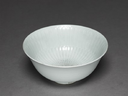 White ware bowl with fluted decorationoblique