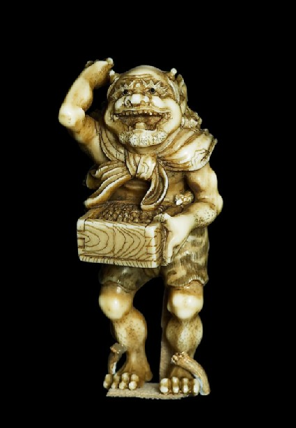 Okimono, or ornament, in the form of a devil throwing beans at the Setsubun festivaloblique