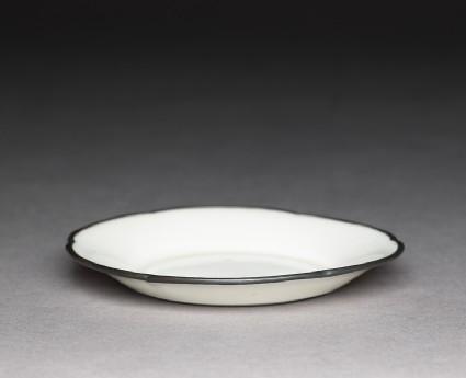 White ware dish with copper rimoblique