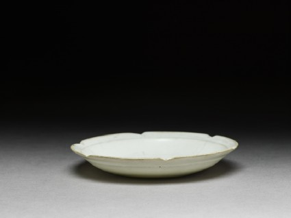 White ware dish with flattened and lobed rimoblique