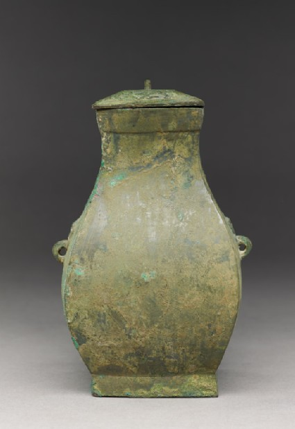 Square ritual wine vessel, or fang hu, with animal mask handlesside